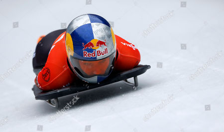 Germany's Anja Huber speeds down the track during her first run of the women's Skeleton World Cup race in Koenigssee, southern Germany, on