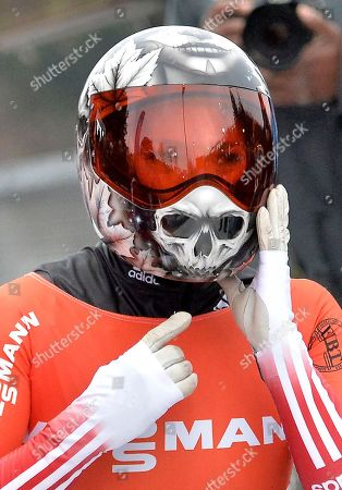 Sarah Reid from Canada touches her helmet during the women's Skeleton World Cup in Winterberg, Germany, on . Reid finished third