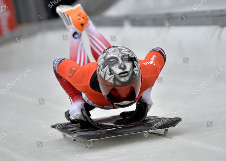 Sarah Reid from Canada jumps on her sledge during the women's Skeleton World Cup in Winterberg, Germany, on . Reid finished third