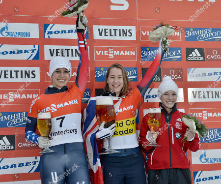 Elizabeth Yarnold of Great Britain, center, celebrates on the podium after winning the women's Skeleton World Cup in Winterberg, Germany, on . Noelle Pikus-Pace of the USA finished second, left, Sarah Reid from Canada finished third, right