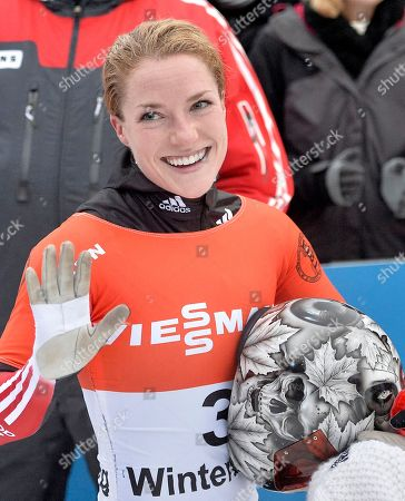 Sarah Reid from Canada waves to fans during the women's Skeleton World Cup in Winterberg, Germany, on . Reid finished third