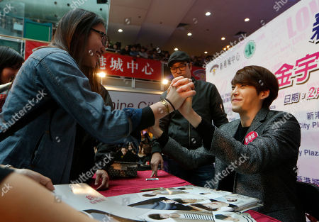 Kim Woo Bin South Korean actor and model Kim Woo Bin shakes hands with a fan as he gives her his autograph during a meeting in Hong Kong
