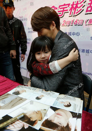 Kim Woo Bin South Korean actor and model Kim Woo Bin hugs a girl during a fan meeting in Hong Kong