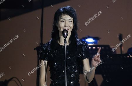 Maggie Cheung Hong Kong actress Maggie Cheung speaks during a memorial concert to mark the 10th anniversary of the death of Hong Kong singer-actress Anita Mui in Hong Kong, . Anita Maui was one of the most popular singer-actress in Asia. Mui released 30 Canto-Pop albums, more than 40 movies and held 292 concerts in worldwide. Mui died of cancer at the age of 40, on Dec. 30, 2003