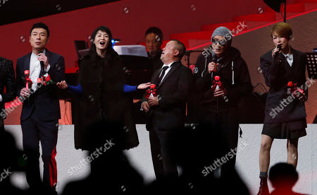 Stock Picture of Andy Hui, Maggie Cheung, Tony Leung, Eric Tsang, Sammi Cheng From left, Hong Kong performing artists Andy Hui, Maggie Cheung, Tony Leung, Eric Tsang and Sammi Cheng sing during a memorial concert held to mark the 10th anniversary of the death of Hong Kong singer-actress Anita Mui in Hong Kong . Anita Maui was one of the most popular singer-actress in Asia. Mui released 30 Canto-Pop albums, more than 40 movies and held 292 concerts in worldwide. Mui died of cancer at the age of 40, on December 30, 2003