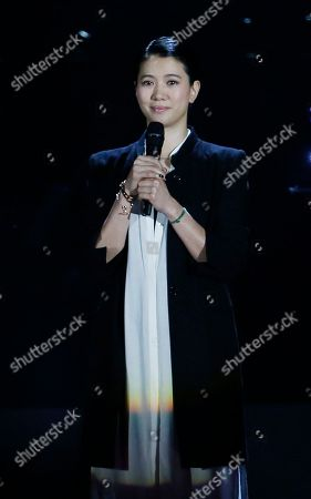 Stock Image of Anita Yuen Hong Kong actress Anita Yuen speaks during a memorial concert to mark the 10th anniversary of the death of Hong Kong singer-actress Anita Mui in Hong Kong . Anita Maui was one of the most popular singer-actress in Asia. Mui released 30 Canto-Pop albums, more than 40 movies and held 292 concerts in worldwide. Mui died of cancer at the age of 40, on December 30, 2003