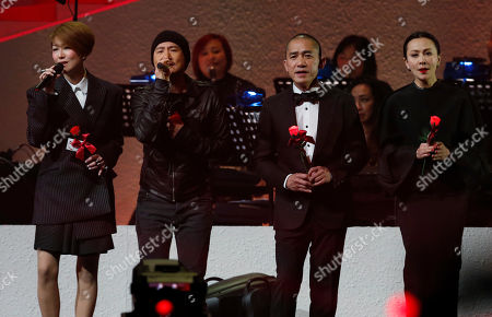 Sammi Cheng, Jacky Cheung, Tony Leung, Carina Lau From left, Hong Kong performing artists, Sammi Cheng, Jacky Cheung, Tony Leung and Carina Lau sing during a memorial concert to mark the 10th anniversary of the late Hong Kong singer-actress Anita Mui's death, in Hong Kong . Anita Maui was one of the most popular singer-actress in Asia. Mui released 30 Canto-Pop albums, more than 40 movies and held 292 concerts in worldwide. Mui died of cancer at the age of 40, on December 30, 2003