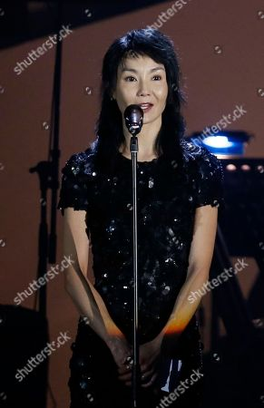 Maggie Cheung Hong Kong movie star Maggie Cheung speaks during a memorial concert to mark the 10th anniversary of the death of Hong Kong singer-actress Anita Mui in Hong Kong, . Anita Maui was one of the most popular singer-actress in Asia. Mui released 30 Canto-Pop albums, more than 40 movies and held 292 concerts in worldwide. Mui died of cancer at the age of 40, on December 30, 2003