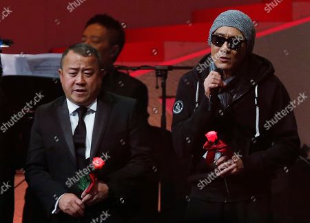 Tony Leung, Eric Tsang From left, Hong Kong performing artists Tony Leung, right, and Eric Tsang sing during a memorial concert to mark the 10th anniversary of the death of Hong Kong singer-actress Anita Mui's in Hong Kong . Anita Maui was one of the most popular singer-actress in Asia. Mui released 30 Canto-Pop albums, more than 40 movies and held 292 concerts in worldwide. Mui died of cancer at the age of 40, on December 30, 2003