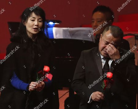 Maggie Cheung, Eric Tsang Hong Kong performing artists Maggie Cheung, left and Eric Tsang sing during a memorial concert to mark the 10th anniversary of the death of Hong Kong singer-actress Anita Mui in Hong Kong, . Anita Maui was one of the most popular singer-actress in Asia. Mui released 30 Canto-Pop albums, more than 40 movies and held 292 concerts in worldwide. Mui died of cancer at the age of 40, on Dec. 30, 2003