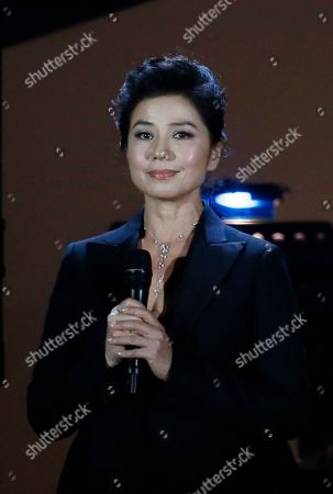 Stock Image of Cherie Chung Hong Kong actress Cherie Chung sings during a memorial concert to mark the 10th anniversary of the death of Hong Kong singer-actress Anita Mui in Hong Kong, . Anita Maui was one of the most popular singer-actress in Asia. Mui released 30 Canto-Pop albums, more than 40 movies and held 292 concerts in worldwide. Mui died of cancer at the age of 40, on December 30, 2003