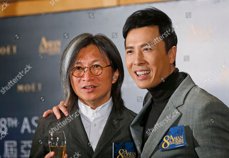 Peter Chan, Donnie Yen Jury President, Hong Kong director Peter Chan, left, and Celebrity Jury, martial art movie star Donnie Yen pose during the news conference of the Asian Film Awards (AFA) in Hong Kong . An annual Asian Film Awards will be held in Macau on March 27