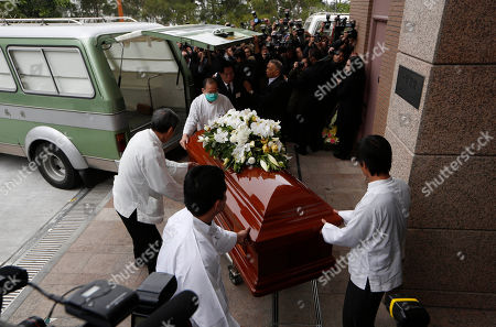 "Staff members carry the coffin of Hong Kong movie producer Run Run Shaw from a hearse upon arrival for his funeral at the Cape Collinson Crematorium in Hong Kong . Shaw built a Hong Kong movie and TV empire that nurtured rising talents like actor Chow Yun-fat and director John Woo, inspired Hollywood filmmakers such as Quentin Tarantino and produced the 1982 sci-fi classic ""Blade Runner."" Pioneering Hong Kong movie producer Shaw died on Tuesday at the age of 107"