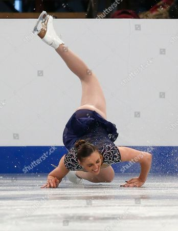 Great Britain's Jenna McCorkell falls during the women's short program at the European Figure Skating Championships in Budapest, Hungary