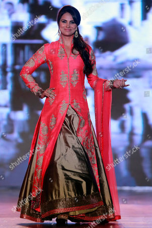 Bollywood actress Lara Dutta displays an outfit by Indian designer Manish Malhotra during a fashion show to support the cause of saving and empowering the female child in Mumbai, India