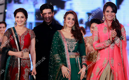 Bollywood actresses Madhuri Dixit, left, Lara Dutta right, and Prety Zinta wear designs by Indian designer Manish Malhotra, second left, during a fashion show to support the cause of saving and empowering the female child in Mumbai, India