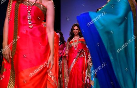 Cosmetic physician Jamuna Pai displays a creation by Indian designer Mandira Bedi during the Lakme Fashion Week in Mumbai, India