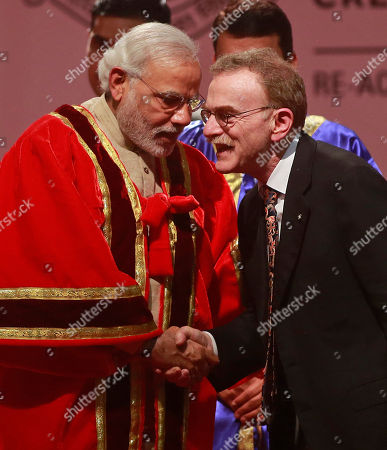 Stock Photo of Narendra Modi Indian Prime Minister Narendra Modi, left, speaks with Randy Wayne Schekman, Nobel laureate for Physiology or Medicine, during the inauguration of the 102nd Indian Science Congress in Mumbai, India, . More than 12,000 delegates from all over country are expected to participate in the 2015 Indian Science Congress