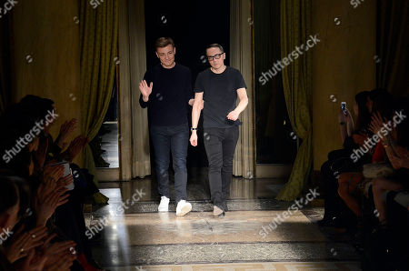 Fashion designers Tommaso Aquilano, right, and Roberto Rimondi acknowledge the audience after presenting their women's Fall-Winter 2014-15 collection, part of the Milan Fashion Week, unveiled in Milan, Italy