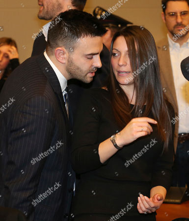 Lyle Kercher, Stephanie Kercher Meredith Kercher's brother Lyle, left, and sister Stephanie talk after the reading of the verdict for the murder of British student Meredith Kercher, in Florence, Italy, . An appeals court in Florence upheld the convictions of U.S. student Amanda Knox and her ex-boyfriend for the 2007 murder of her British roommate. Knox was sentenced to 28 1/2 years in prison, raising the specter of a long legal battle over her extradition. After nearly 12 hours of deliberation Thursday the court reinstated the guilty verdict first handed down against Knox and Raffaele Sollecito in 2009