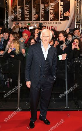 """American writer Robert Morse Edsel poses for photographers on the red carpet for the screening of the movie """"Monuments Men """", in Pioltello, near Milan"""