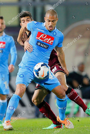 Napoli's Gokhan Inler of Switzerland, front, fights for the ball witht Livorno's Leandro Greco during a Serie A soccer match between Livorno and Napoli, in Leighorn, Italy