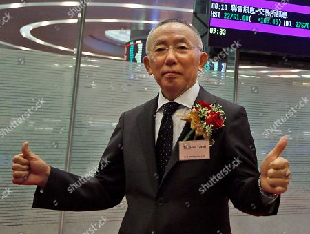 Tadashi Yanai Tadashi Yanai, chief executive of Fast Retailing Co. Ltd., poses before hitting a gong during its listing ceremony at the Hong Kong Stock Exchange in Hong Kong. The Japanese fashion chain said it will expand monitoring of factories operated by its suppliers following complaints over labor violations and other problems. The company plans to have a pilot program involving 30 percent of the fabrics used in Uniqlo clothing in place by the end of March, and to expand it to all of its textile suppliers by the end of March 2016