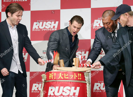 "Stock Photo of Chris Hemsworth, Daniel Bruhl, Ron Howard, Kazuhiro Kiyohara Actors Chris Hemsworth, center, Daniel Bruhl, left, former Japanese baseball player Kazuhiro Kiyohara, second from right, and director Ron Howard hit a barrel of sake during a traditional Japanese ""Kagamiwari "" ceremony during a press conference for their movie ""Rush"" in Tokyo"