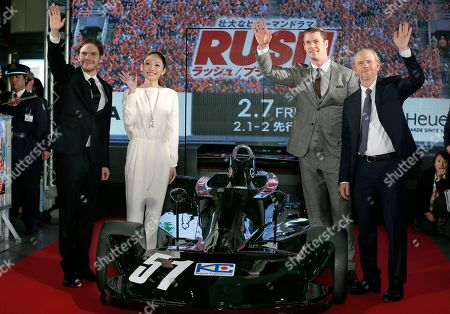 """Chris Hemsworth, Daniel Bruhl, Ron Howard, Miki Ando Actors Daniel Bruhl, left, Chris Hemsworth, second from right, director Ron Howard, right, and Japanese former figure skater Miki Ando wave to fans during the Japan premiere of the movie """"Rush"""" in Tokyo"""