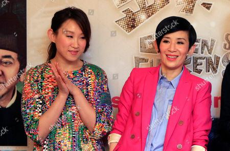 "Sandra Ng, Ivana Wong Hong Kong actresses Ivana Wong, left, and Sandra Ng pose for photographers during a press conference to promote their new film ""Golden Chicken SSS"" in Petaling Jaya, near Kuala Lumpur, Malaysia"