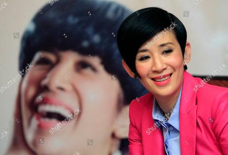 """Sandra Ng Hong Kong actress Sandra Ng smiles during a press conference to promote her new film """"Golden Chicken SSS"""" in Petaling Jaya, near Kuala Lumpur, Malaysia"""