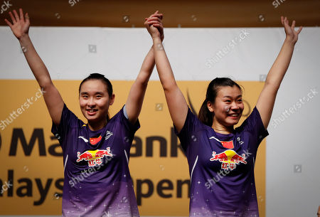 Bao Yixin, Tang Jinhua China's Bao Yixin, left, celebrates with her teammate Tang Jinhua during an awarding ceremony after they won the women's double final match against Misaki Matsutomo and Ayaka Takahashi of Japan at the Malaysia Open Badminton Super Series in Kuala Lumpur, Malaysia