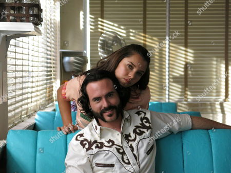 """Stock Picture of Mexican actors Sara Maldonado and Erik Hayser pose for a photo during a break in the recording of the upcoming TV series """"Camelia la Texana"""" """", in Pachuca, Mexico. Maldonado plays the role of """"Camelia la Texana"""" a fictional character depicted in the famous corrido """"Contrabando y traición"""" or """"Contraband and betrayal"""" one of the biggest hits by Mexican norteno band Los Tigres del Norte"""