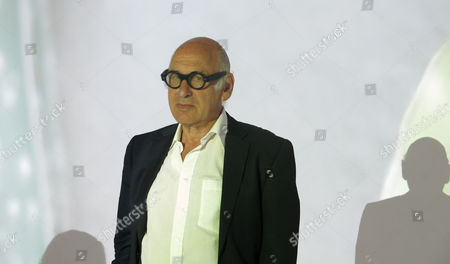 """Michael Nyman British composer Michael Nyman poses for pictures during a press tour of his video installation; """"Manejese sin demoras. Deben exhibirse en fecha exacta,"""" in Mexico City, . The installation gathers videos that Nyman has shot in Mexico for a period of six years ago. Nyman, renowned for composing music for various films, said that making films is more enjoyable than creating music"""