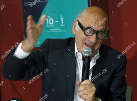 """Michael Nyman British composer Michael Nyman speaks during a press conference to promote his video installation, """"Manejese sin demoras. Deben exhibirse en fecha exacta,"""" in Mexico City on . The installation gathers videos that Nyman has shot in Mexico for six years ago. Nyman said that the soundtrack of his installation is the most revolutionary music composition he has ever created"""