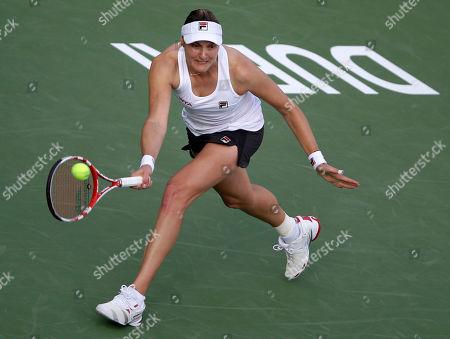 Nadia Petrova Nadia Petrova of Russia returns the ball to Carla Suarez Navarro of Spain during the first round of Dubai Duty Free Tennis Championships in Dubai, United Arab Emirates