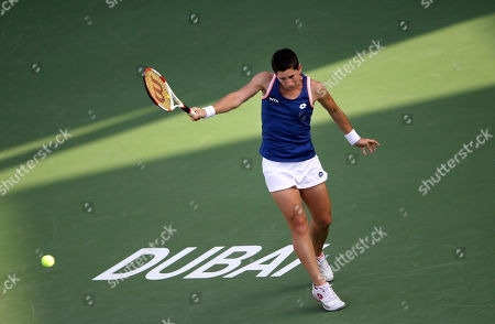 Carla Suarez Navarro Carla Suarez Navarro of Spain returns the ball to Nadia Petrova of Russia during the first round of Dubai Duty Free Tennis Championships in Dubai, United Arab Emirates