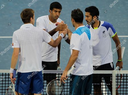 Rohan Bopanna, Aisam-Ul- Haq Qureshi Rohan Bopanna of India, second left, and Aisam-Ul- Haq Qureshi of Pakistan, right, shakes hands with Daniel Nestor of Canada and Nenad Zimonjic of Serbia after Bopanna and Qureshi won the doubles final match of the Dubai Duty Free Tennis Championships in Dubai, United Arab Emirates