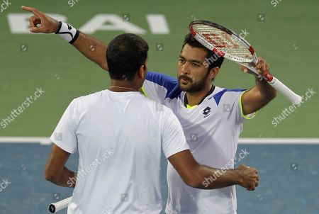 Rohan Bopanna, Aisam-Ul- Haq Qureshi Rohan Bopanna of India, left, and Aisam-Ul- Haq Qureshi of Pakistan, hug each other after they beat Daniel Nestor of Canada and Nenad Zimonjic of Serbia in the doubles final match of the Dubai Duty Free Tennis Championships in Dubai, United Arab Emirates