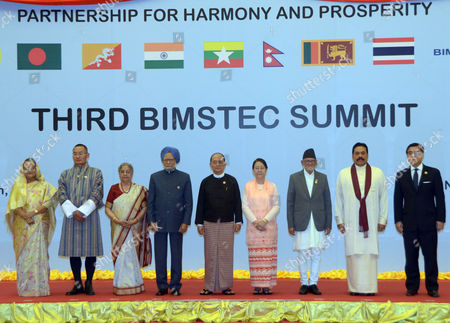 From left, Bangladesh Prime Minister Sheikh Hasina, Bhutan Prime Minister Tshering Tobgay, Gursharan Kaur, wife of India Prime Minister, India Prime Minister Manmohan Singh, Myanmar President Thein Sein, and his wife Khin Khin Win, Nepal Prime Minister Sushil Kairala, Sri Lanka President Mahinda Rajapaksa, and Thai Foreign Ministry's Permanent Secretary Sihasak Phuang Ketkeow, pose for group photos during the Gala Dinner marking for the third Bay of Bengal Initiative for Multi-Sectoral Technical and Economic Cooperation (BIMSTEC) summit at Myanmat International Convention Centre (MICC) in Naypyitaw, Myanmar