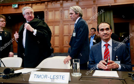 East Timor delegation from right: Joachim de Fonseca, Stephen Webb, Michael Wood and Janet Legrand, prior to the start of public hearings at the International Court of Justice (ICJ) in The Hague, Netherlands, . The United Nations' highest court has banned Australia from making any use of documents it seized from a lawyer working for East Timor in an arbitration case over a multibillion-dollar oil and gas deal between the two nations. The ICJ also ordered Canberra not to 'interfere in any way in communications' between East Timor and its legal advisers in the arbitration or future negotiations on a maritime boundary between resources-rich Australia and its tiny, impoverished northern neighbor