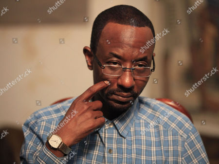 Lamido Sanusi, Nigeria's ousted central bank chief listen to a question during an interview in Lagos, Nigeria, . Nigerian security agents have seized the passport and are plotting to arrest Sanusi who was ousted as Central Bank governor after he revealed that billions of petrodollars are missing from the treasury, a friend and former Cabinet minister said Friday