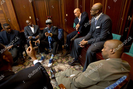 Dennis Rodman Charles D. Smith, Cliff Robinson, Rodman, Doug Christie, Vin Baker Dennis Rodman speaks with fellow US basketball players during a team meeting at a Pyongyang, North Korea hotel . Rodman came to the North Korean capital with a team of USA basketball stars for an exhibition game on Jan. 8, the birthday of North Korean leader Kim Jong Un. Clockwise from bottom left are Charles D. Smith, unidentified, Cliff Robinson, Rodman, Doug Christie, Vin Baker, and unidentified