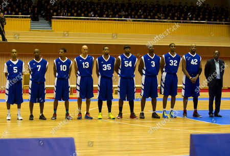 """Andre """"Silk"""" Poole, Kenny Anderson, Guy Dupree, Doug Christie, Jerry Dupree, Antoinne Scott, Cliff Robinson, Charles D. Smith, Vin Baker U.S. basketball players line up before an exhibition basketball game at an indoor stadium in Pyongyang, North Korea on . From left to right are Andre """"Silk"""" Poole, Kenny Anderson, Guy Dupree, Doug Christie, Jerry Dupree, Antoinne Scott, Cliff Robinson, Charles D. Smith and Vin Baker"""