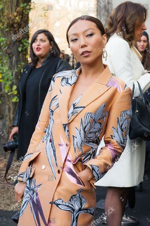 Bao Bao Wan Chinese jewelry designer Bao Bao Wan poses for photographers as she arrives to attend the Dior men's Fall-Winter 2014-2015 fashion collection, presented in Paris