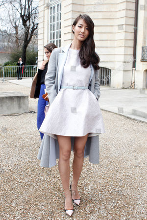 Japenese model Sumire Matsubara poses for photographers before Dior's ready-to-wear fall/winter 2014-2015 fashion collection presented in Paris, Friday, Feb.28, 2014
