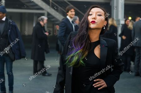 Bao Bao Wan Jewelry designer Bao Bao Wan of China poses for photographers as she arrives to attend the Givenchy men's Fall-Winter 2014-2015 fashion collection, presented in Paris