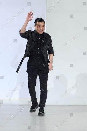 Arashi Yanagawa Fashion designer Arashi Yanagawa acknowledges applause following the presentation of the men's Fall-Winter 2014-2015 fashion collection he designed for John Lawrence Sullivan, in Paris