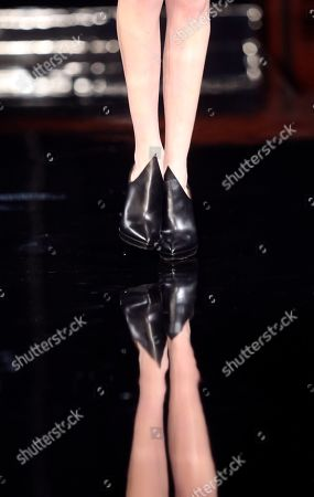 Legs of a model are reflected as she wears a creation for Tex Saverio's ready to wear fall/winter 2014-2015 fashion collection presented in Paris, Tuesday, Feb.25, 2014