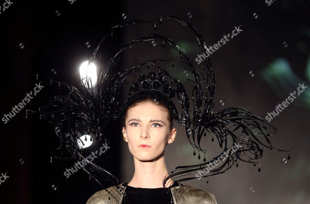 A model wears a creation for Tex Saverio's ready to wear fall/winter 2014-2015 fashion collection presented in Paris, Tuesday, Feb.25, 2014